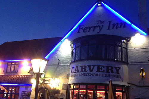 The Ferry Inn illuminated at night on the Norfolk Broads.