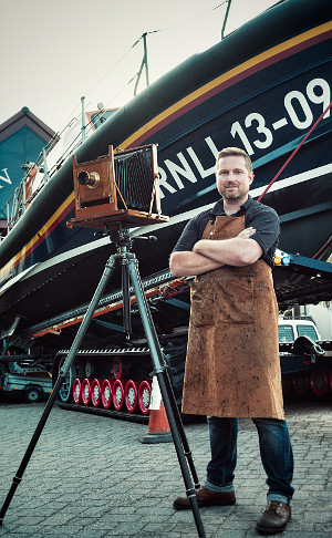 Jack Lowe with Victorian Camera in front of Lifeboat